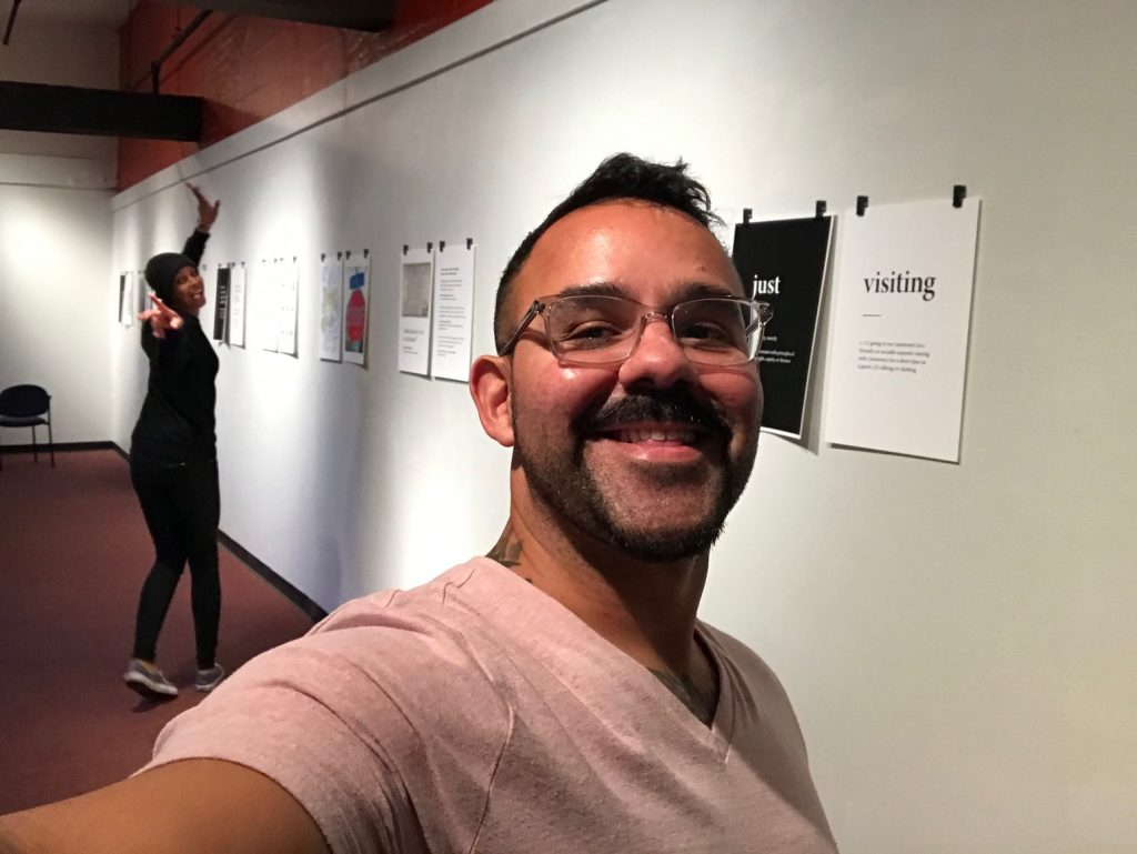 miguel takes a selfie with kate during print installation